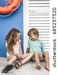 brother and sister cuddling on... | Shutterstock . vector #685257520