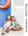 brother and sister cuddling on... | Shutterstock . vector #685257568