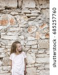 pretty girl in front of a stone ... | Shutterstock . vector #685257760