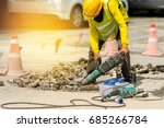 worker drilling concrete... | Shutterstock . vector #685266784