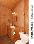 Cabin Bathroom With Orange...