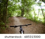 a bicycle stands on a dirt path ... | Shutterstock . vector #685315000