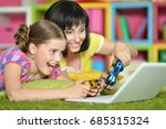 mother and daughter playing... | Shutterstock . vector #685315324