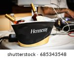 Small photo of MOSCOW-25 JULY,2017: Bottles of expensive luxury French cognac Hennessy in ice bucket on party.Lux alcohol drinks on table.Hennessey cognac bottles cooling down in ice.Old elite strong alcoholic drink