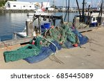 Fishing Boat And Nets At A Pie...