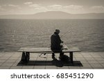 solitary fisherman | Shutterstock . vector #685451290