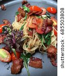Small photo of Angel hair spaghetti stir fried with bacon, chilli and basil