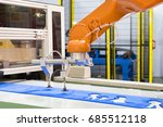 automated robotic arm picking... | Shutterstock . vector #685512118