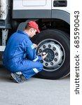 A Mechanic Checks The Tire...