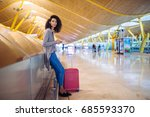 woman waiting her flight using... | Shutterstock . vector #685593370