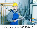 positive young french plasterer ... | Shutterstock . vector #685598410