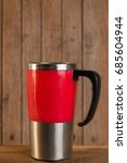Small photo of Water glass of aluminum (Aluminum mug) on wooden floor and have green color nature in backdrop.