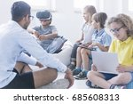 afro american boy uses vr... | Shutterstock . vector #685608313
