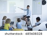 teacher shows students how to... | Shutterstock . vector #685608328