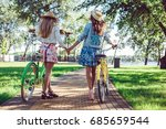 rear view of two women holding... | Shutterstock . vector #685659544