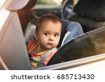 adorable baby in safety car... | Shutterstock . vector #685713430