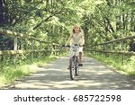 little girl on a bicycle in... | Shutterstock . vector #685722598