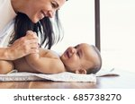 happy mother playing with baby... | Shutterstock . vector #685738270
