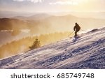 Silhouette Of Skier On The Top...