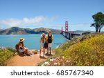 Family looking at beautiful summer mountains landscape, on hiking trip.  Golden Gate Bridge, over Pacific Ocean, mountains in the background. San Francisco, California, USA
