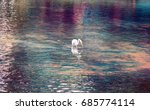 Small photo of Great white egret (American egret, Egretta alba)hunting for small fish in mountain pond with clear water. Bill as throwing spear, bird kills fish with lightning speed. Beautiful glare and reflections