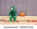 Little Boy In Dragon Costume...