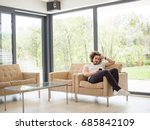 handsome casual young man using ... | Shutterstock . vector #685842109