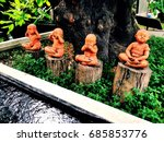 four statues sitting on stumps... | Shutterstock . vector #685853776