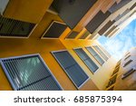 look up view yellow condominium ... | Shutterstock . vector #685875394