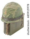 Small photo of Green Ammo Box with ammunition belt and helmet