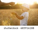 female hands pour the boy in... | Shutterstock . vector #685916188
