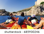 Kayaking between rocks on the adriatic sea in Dubrovnik  - stock photo
