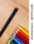 Small photo of Authority word written on black pencil. Colored pencils. Authority, power, competence, supreme, business, school, education concepts