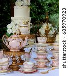 Stock photo pink and gold vintage high tea party teacups teapot cake stands wedding cake and crown 685970923