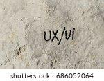 ux ui written on rock texture ...