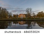 Small photo of Rich manor with a park and a pond at sunrise. Palmse, Estonia.