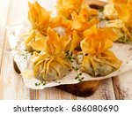 spinach and feta phyllo purses... | Shutterstock . vector #686080690