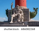 Small photo of Saint Petersburg, Russia - June 17, 2017: South rostral column. The male figure allegorically represents the Dnieper River. Earlier rostral column represented the Navy and served as a beacon of glory.