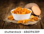 sweet potato chips on an old... | Shutterstock . vector #686096389