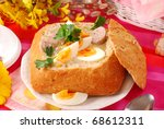 white borscht with eggs and sausage in bread bowl for easter - stock photo