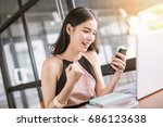 young asian woman happy with... | Shutterstock . vector #686123638