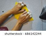 hands of a female climbing | Shutterstock . vector #686142244