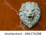 Lion Face Statue On The Wall