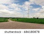 road to wind turbine on green... | Shutterstock . vector #686180878
