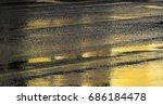 wet asphalt road with golden... | Shutterstock . vector #686184478