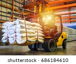 forklift handling sugar bag for ... | Shutterstock . vector #686184610