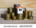 dollhouse on coins on the... | Shutterstock . vector #686208400