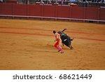 "SEVILLE - APRIL 30:  The bull chases Bullfighter David Fandila ""El Fandi"" as he fights for a sold out crowd at the Plaza de Toros de Sevilla April 30, 2009 in Seville, Spain. - stock photo"