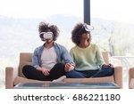 multiethnic couple using... | Shutterstock . vector #686221180