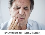 Old Man With Toothache